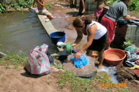 women of El Junco do their daily laundry at the water source area