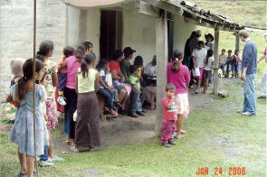 Patients wait in line to see a doctor